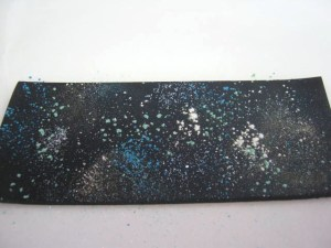 spattered mica powder on black clay